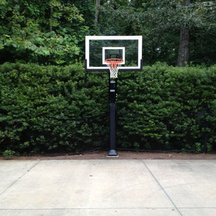 Photo of a large traditional partial sun front yard outdoor sport court in Raleigh.