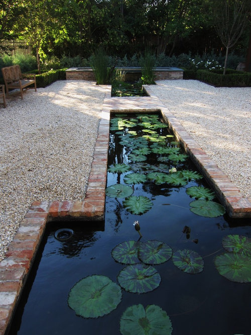 Lotus pond home design ideas pictures remodel and decor for Brick fish pond