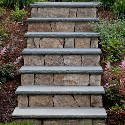 Inspiration for a traditional hillside stone landscaping in Boston.