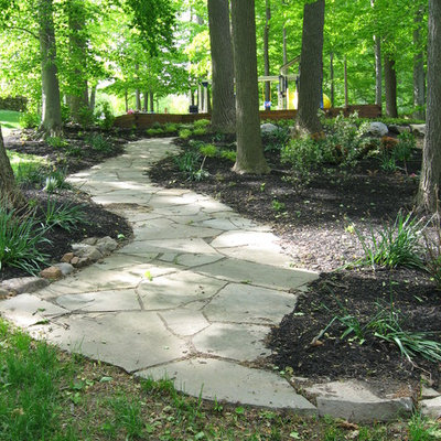 Inspiration for a large traditional backyard stone landscaping in Philadelphia.