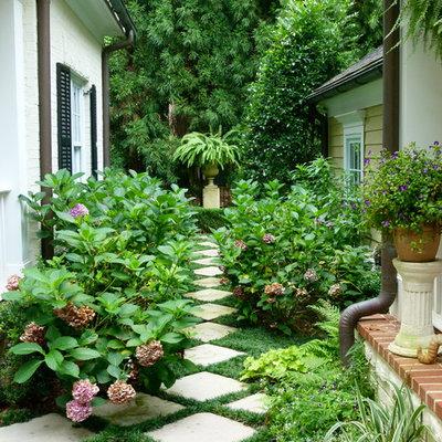 Inspiration for a traditional full sun concrete paver garden path in Atlanta.