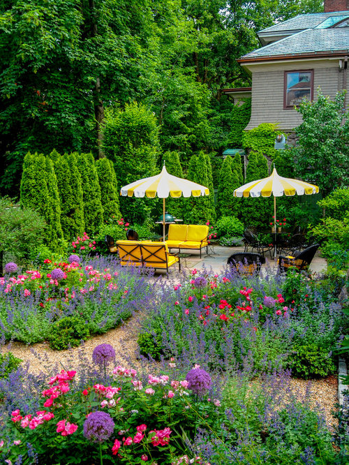 Photo Of A Mid Sized Traditional Full Sun Side Yard Stone Formal Garden In  Boston