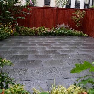 Photo of a small contemporary full sun backyard stone formal garden in New York for summer.