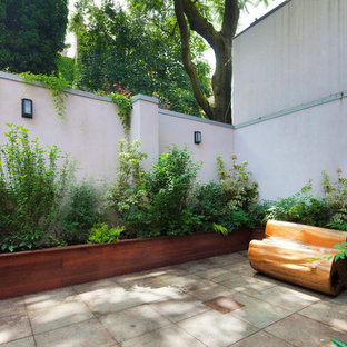 Contemporary backyard shaded garden in New York with a container garden and natural stone pavers.