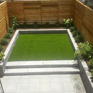 Inspiration for a mid-sized modern full sun backyard concrete paver landscaping in New York.