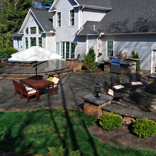 Design ideas for a large traditional full sun backyard concrete paver landscaping in Philadelphia with a fire pit.