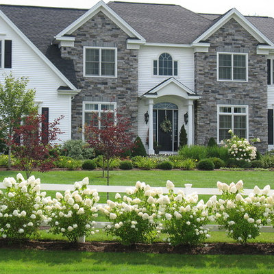 Inspiration for a large traditional full sun front yard mulch formal garden in Burlington.