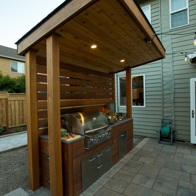 Inspiration for a large contemporary full sun backyard stone landscaping in Portland.