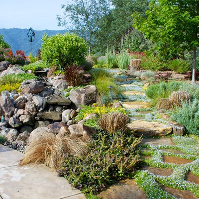 Inspiration for a traditional full sun stone water fountain landscape in San Francisco.