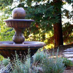 Photo of a large asian drought-tolerant and partial sun front yard brick water fountain landscape in San Francisco.