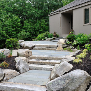 Design ideas for a mid-sized traditional front yard stone landscaping in Boston.