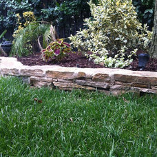 Traditional Landscape by Overland Remodeling & Builders