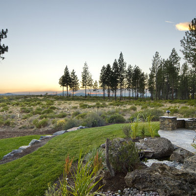 Design ideas for a huge traditional backyard landscaping in Seattle.