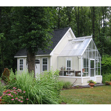Cape Cod Home Attached Greenhouse - Cape Cod Home attached greenhouse.  Built to match existing roof line with exterior flashing and energy efficiency.