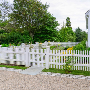 Cape Cod Home. Garden Path and White Picket Fence