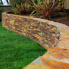Traditional Landscape by KC Construction