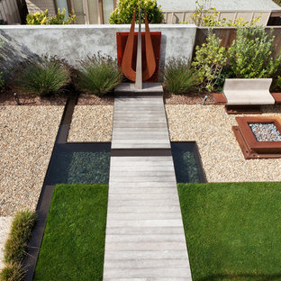 Design ideas for a mid-sized contemporary drought-tolerant backyard concrete paver pond in San Francisco.