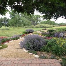 Traditional Landscape by Archevie Design