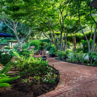 Photo of a large mediterranean shade backyard brick landscaping in San Francisco for summer.