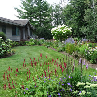 Inspiration for a small arts and crafts front yard partial sun driveway for summer in New York with a garden path and brick pavers.