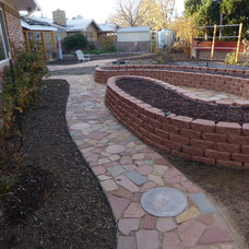 Traditional Landscape by Waterwise Landscapes Incorporated