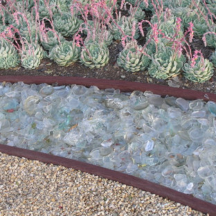 Inspiration for a large contemporary front yard stone driveway in Santa Barbara.