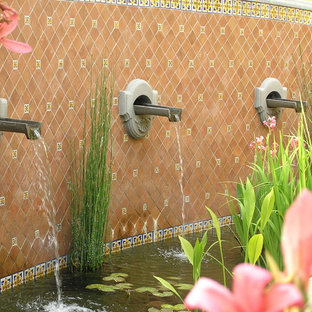 Design ideas for a mediterranean water fountain landscape in Santa Barbara.