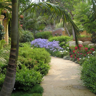Inspiration for a mid-sized mediterranean concrete paver water fountain landscape in Santa Barbara.