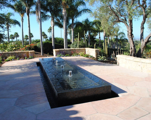 design ideas for a large transitional backyard landscape in santa barbara with a fountain and natural