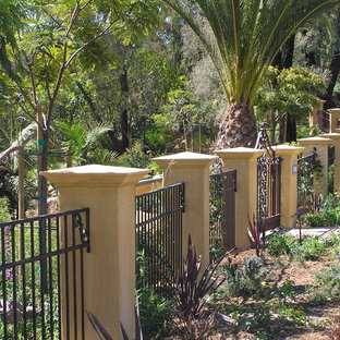 Photo of a large contemporary front yard mulch landscaping in Santa Barbara.