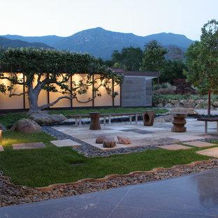 Design ideas for a large modern backyard stone landscaping in Santa Barbara.