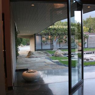 Photo of a large modern backyard stone landscaping in Santa Barbara.