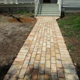 Charming  cottage garden and old bricks for a new ribbon driveway and patio.