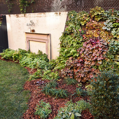 This is an example of a mid-sized rustic partial sun backyard brick formal garden in New York for summer.