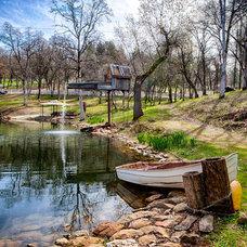 Rustic Landscape by LUXURY,FARM,RANCH & LAND GROUP
