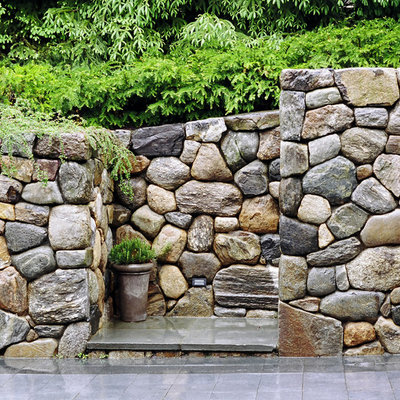 This is an example of a large traditional full sun backyard stone garden path in Boston.