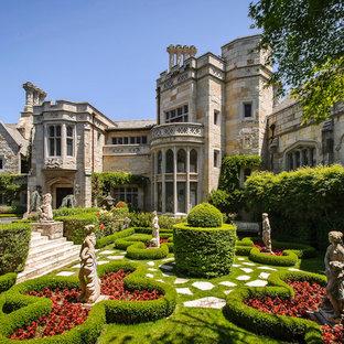 Idee per un ampio giardino formale chic esposto in pieno sole davanti casa con un ingresso o sentiero