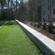Traditional Landscape by PaverStone Construction and Greenmark Landscaping