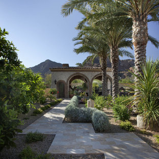 This is an example of a mediterranean backyard stone landscaping in Phoenix.