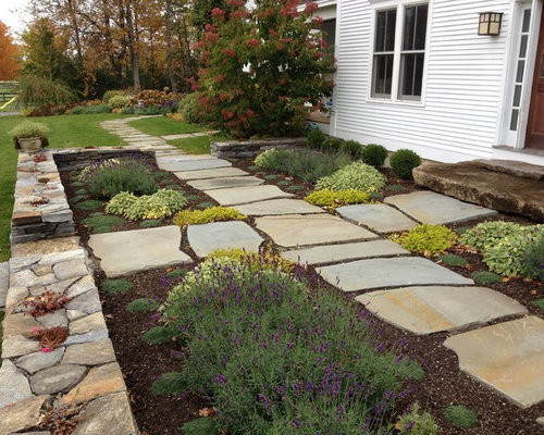 Photo Of A Large Farmhouse Full Sun Backyard Stone Landscaping In  Burlington.