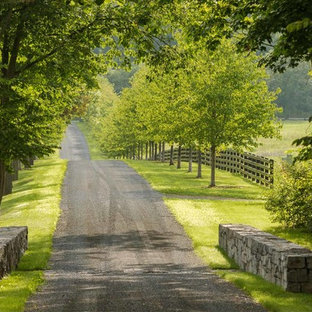 This is an example of a large farmhouse partial sun gravel driveway in Burlington.