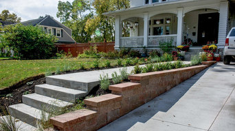 Clean Concrete Drive with Bold Brick Accent Retaining Walls