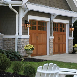 Medium sized traditional front driveway partial sun garden in Cleveland with concrete paving.
