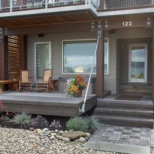 Inspiration for a small contemporary drought-tolerant and partial sun front yard concrete paver landscaping in Seattle.