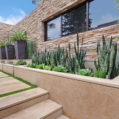Design ideas for a large contemporary drought-tolerant and full sun backyard concrete paver landscaping in Orange County.