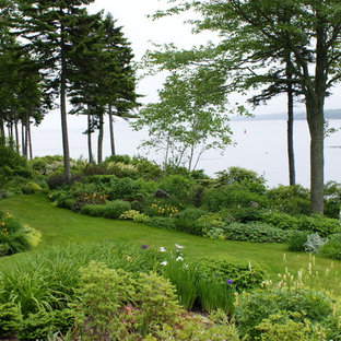 Photo of a beach style backyard landscaping in Portland Maine.
