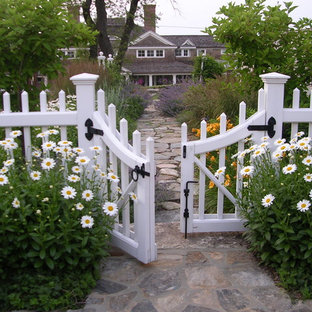 This is an example of a beach style garden in Boston with natural stone paving.