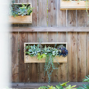 Inspiration for a small farmhouse full sun courtyard landscaping in Orange County with decking.