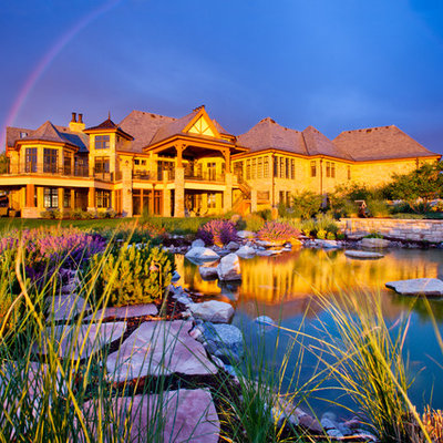 Design ideas for a large traditional full sun backyard stone landscaping in Denver.