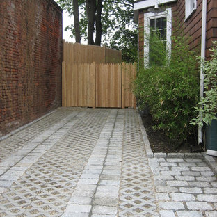 Design ideas for a traditional partial sun front yard gravel driveway in Boston.